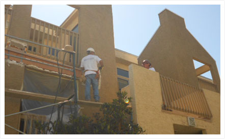Men working with Carlsbad contractor on storefront remodel